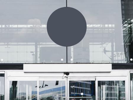 Gray circular signboard mockup in front of a building Zdjęcie Seryjne