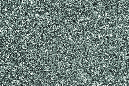 Close up of green glitter textured background Stock Photo