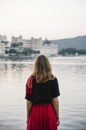 Western woman enjoying a view of Taj Lake in Udaipur