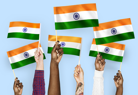 Hands waving flags of India