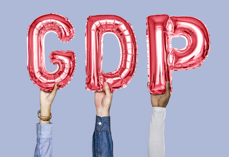 Hands holding GDP word in balloon letters 版權商用圖片