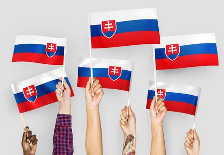 Hands waving flags of Slovakia Stockfoto