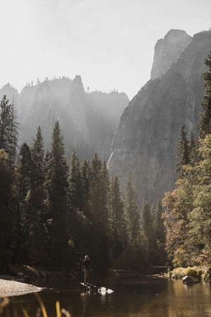 Man enjoying a lake in Yosemite National Park, California, USA