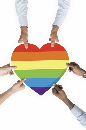 Hands holding a lgbt rainbow heart