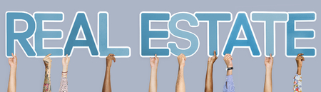Blue letters forming the word real estate Stock Photo - 115668841