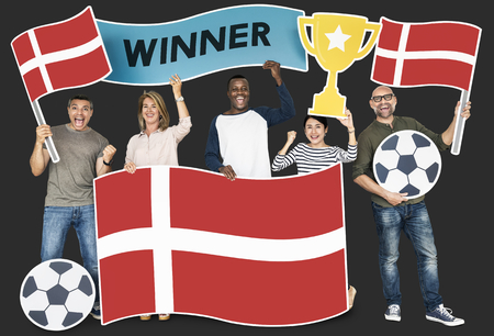 Diverse football fans holding the flag of Denmark Stock Photo