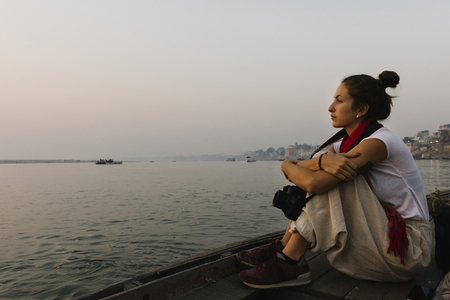 Photographer sitting on a boat on the River Ganges