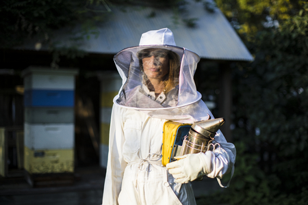 Beekeeper posing with the smoker 写真素材