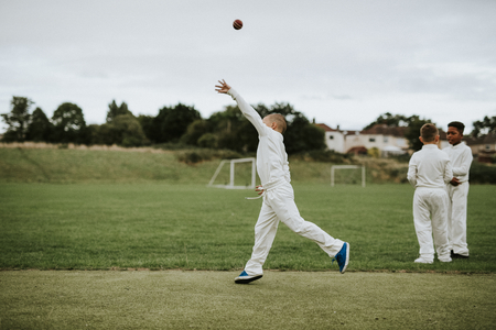 Cricket player catching a ball