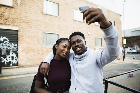 Couple taking a selfie in London