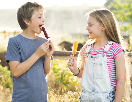 Kids eating ice popsicles