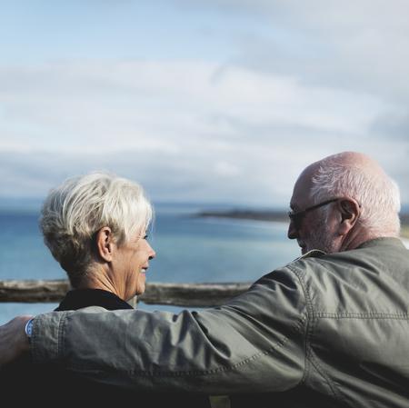 Senior couple enjoying the view of the ocean