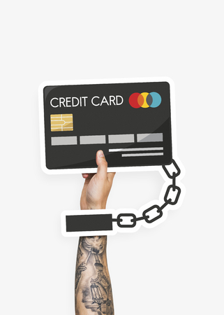 Person holding a chained credit card
