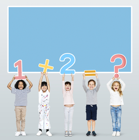 Cheerful diverse kids learning mathematics Stock Photo