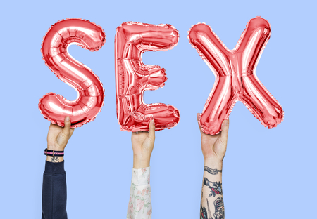 Hands holding sex word in balloon letters Stock Photo