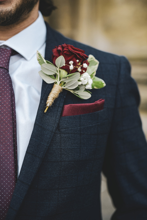 Close up of a groom with a boutonniere