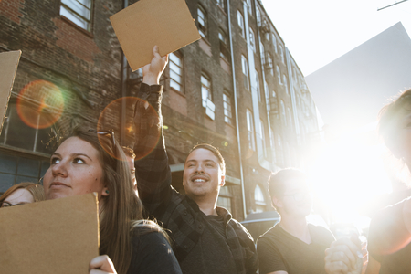 Joyful protesters marching through the city Stock Photo