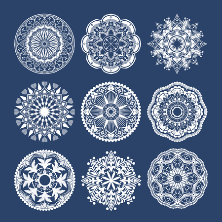 White mandala patterns set on blue background
