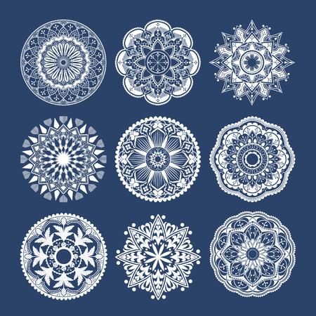 White mandala patterns set on blue background