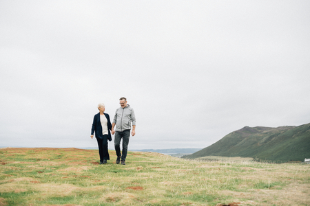 Senior couple holding hands while walking