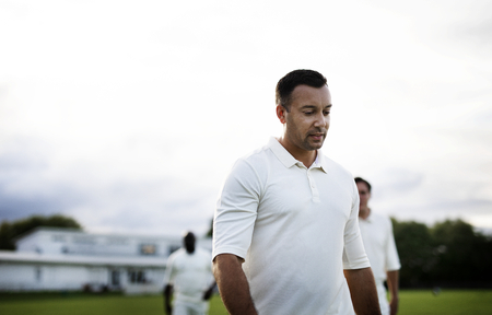 Cricket player dressed in white ready for a match