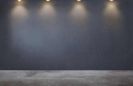 Dark gray wall with a row of spotlights in an empty room Stock Photo