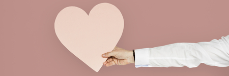 Man holding a pink heart for valentines day Stock Photo