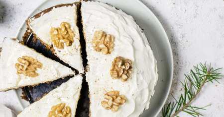 Sliced carrot cake topped with walnuts Stock Photo
