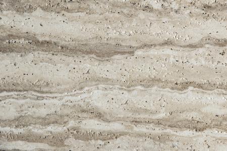 Nahaufnahme eines Natursteins mit Löchern Standard-Bild