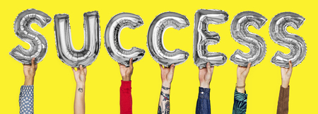 Hands showing success balloons word Stockfoto