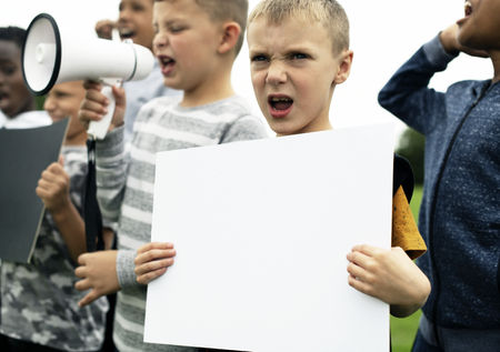 Young boy showing a blank paper in a protest