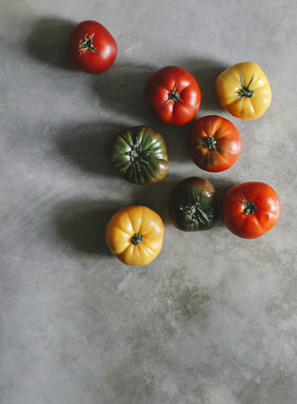 Colorful, fresh and organic heirloom tomatoes Stock Photo