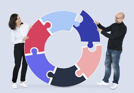 Man and woman with puzzle pieces Stock Photo