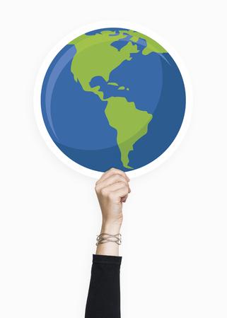 Hand holding a globe cardboard prop