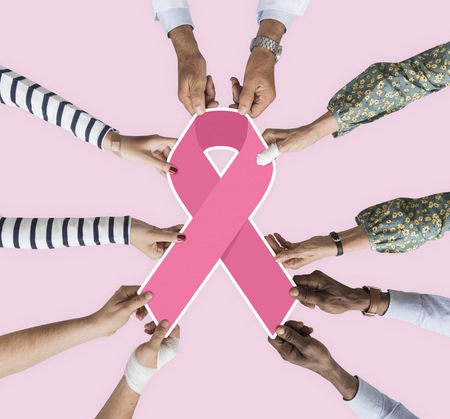 People holding a breast cancer awareness ribbon