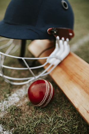 Cricket equipments on green grass Stock Photo