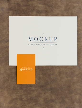Card and tab mockup on brown leather 스톡 콘텐츠