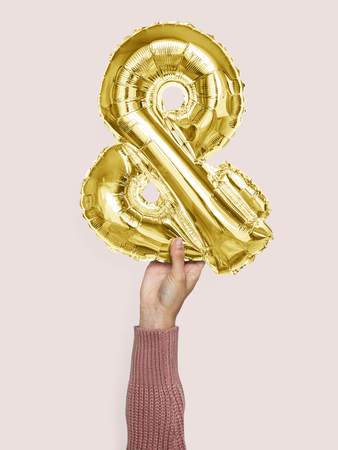 Hand holding balloon and symbol &