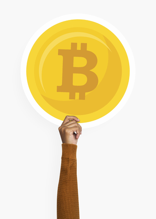 Hand holding a bitcoin cardboard prop