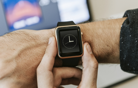 Man checking time on his smartwatch