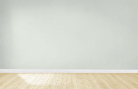 Light green wall in an empty room with a wooden floor 免版税图像 - 115869757