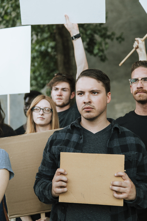 Angry activists protesting in a city Stock Photo