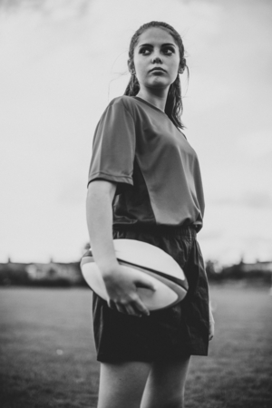 Confident female rugby player on the field