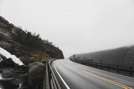 View of highway road in a misty mountain Banco de Imagens