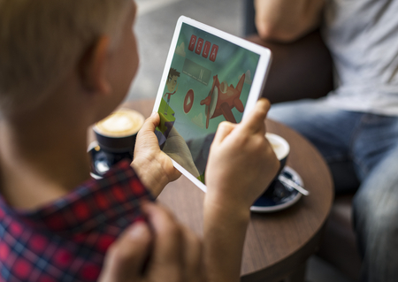 Boy playing word games on a tablet