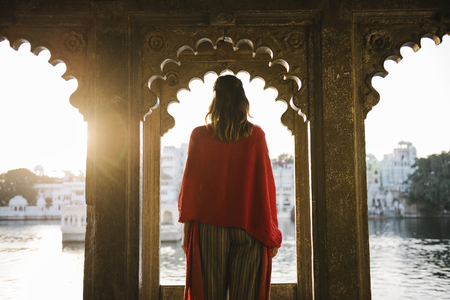 Western woman standing on a cultural architecture in Udaipur, India Stock Photo - 115872049