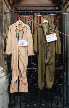 US army jump suit hanging on a gate 写真素材