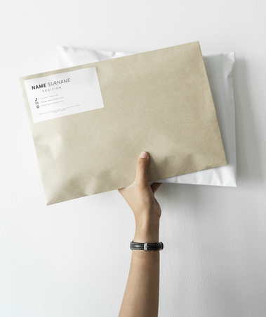 Woman holding two package mockups
