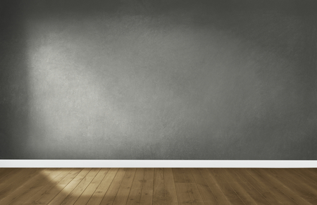 Gray wall in an empty room with a wooden floor