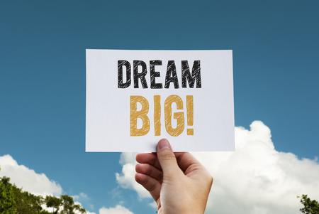 Dream big phrase written on a card